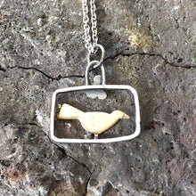 Load image into Gallery viewer, Bronze blackbird in silver frame pendant