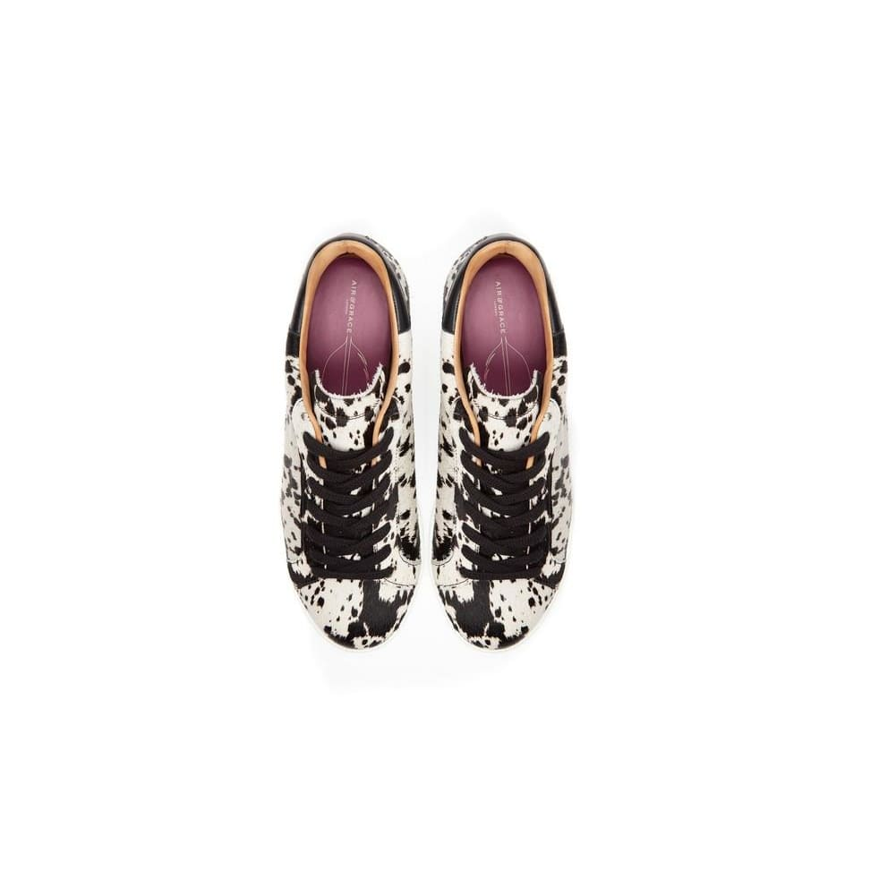 Air & Grace Copeland: Cow Print Trainers