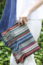 Load image into Gallery viewer, Close of up Woman holding Multicolored Chaguar Clutch Bag with Fringe Ends.