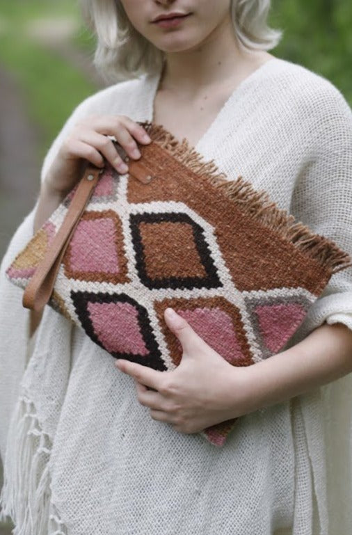 Close up of Cream, Natural Brown, Pink, and Black Geometric Designed Clutch Bag.