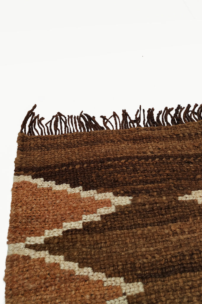 Close up of Fringe Ends with Dark Brown Special Size Wool Tapestry with Cream and Ochre Design details.