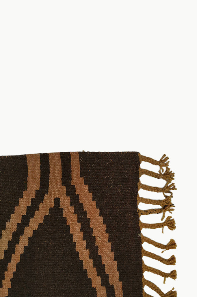 Close up of Dark Brown and Ochre Medium size Wool Tapestry with Large Fringe ends.