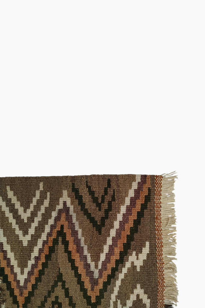Brown Medium size Wool Tapestry with Dark Brown, Cream, and Orange design details. Cream and Dark Brown Fringe ends.
