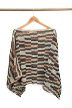 Load image into Gallery viewer, Back of Cream Chaguar Poncho with Red and Black Striped Design Details.