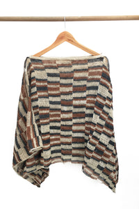 Back of Cream Chaguar Poncho with Red and Black Striped Design Details.