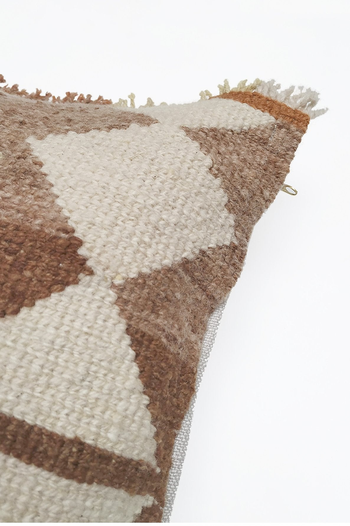 Close up of Natural White Tapestry Wool Cushion with Ochre Diamond Designs.