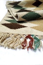 Load image into Gallery viewer, Close up of Cream colored XG Wool Tapestry with Dark Brown and Green Diamond Pattern with Cream Fringe.