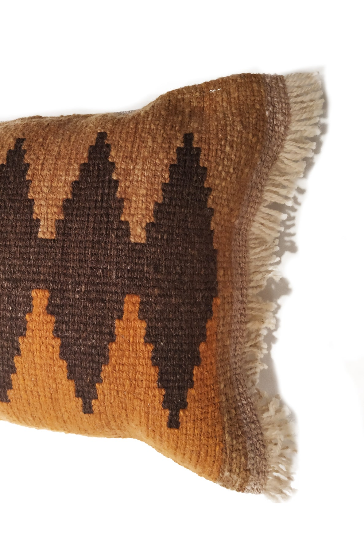 Close up of Orange Tapestry Wool Cushion with Dark Brown Designs.