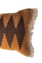 Load image into Gallery viewer, Close up of Orange Tapestry Wool Cushion with Dark Brown Designs.
