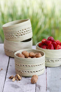 Cream Carandillo Bread Basket with nuts and fruits inside.