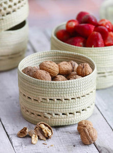 Close up of Cream Carandillo Bread Basket with nuts and fruits inside. Details of Carandillo is shown.