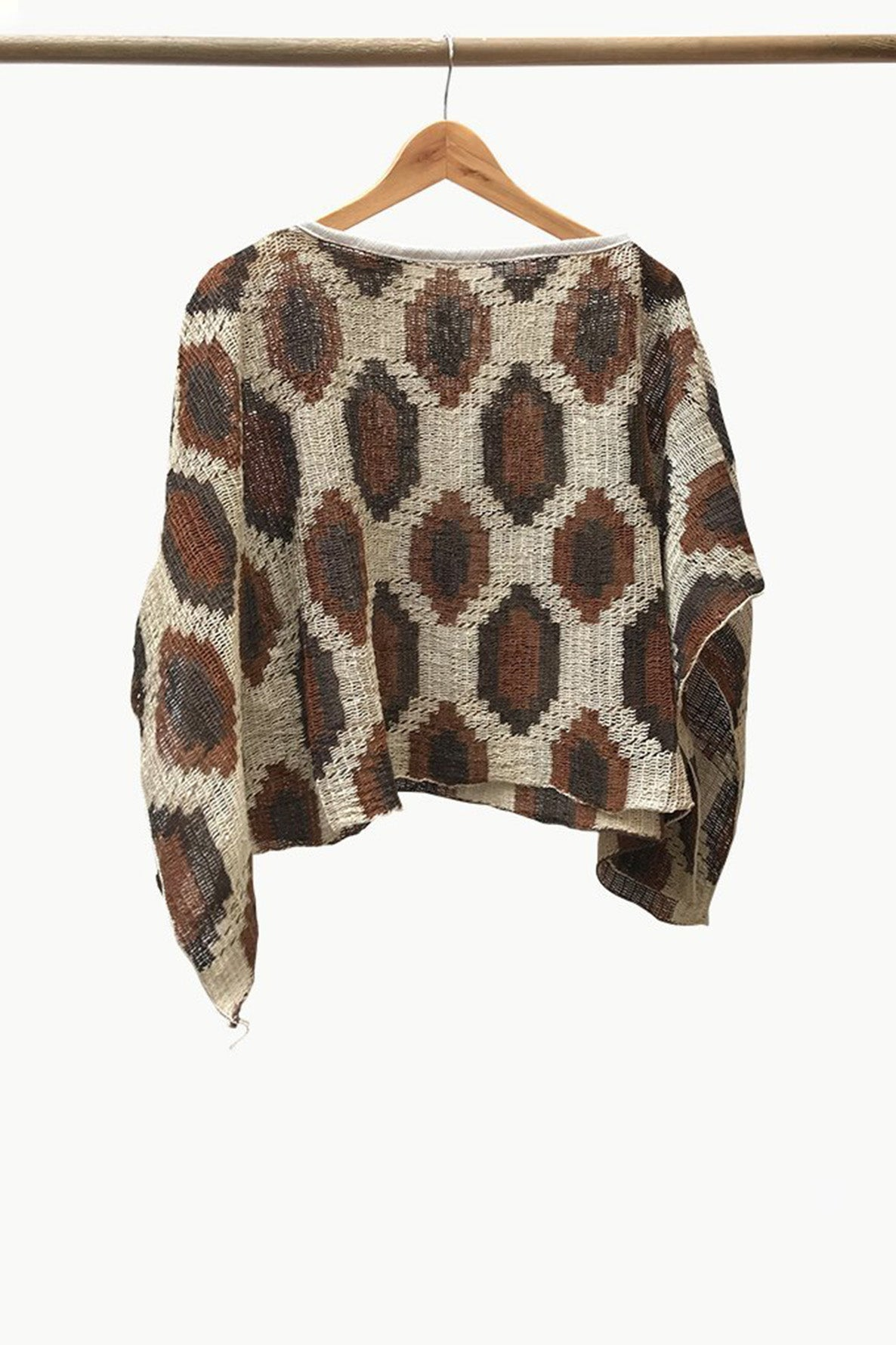 Cream Chaguar Poncho with Brown Hexagonal Design Details.