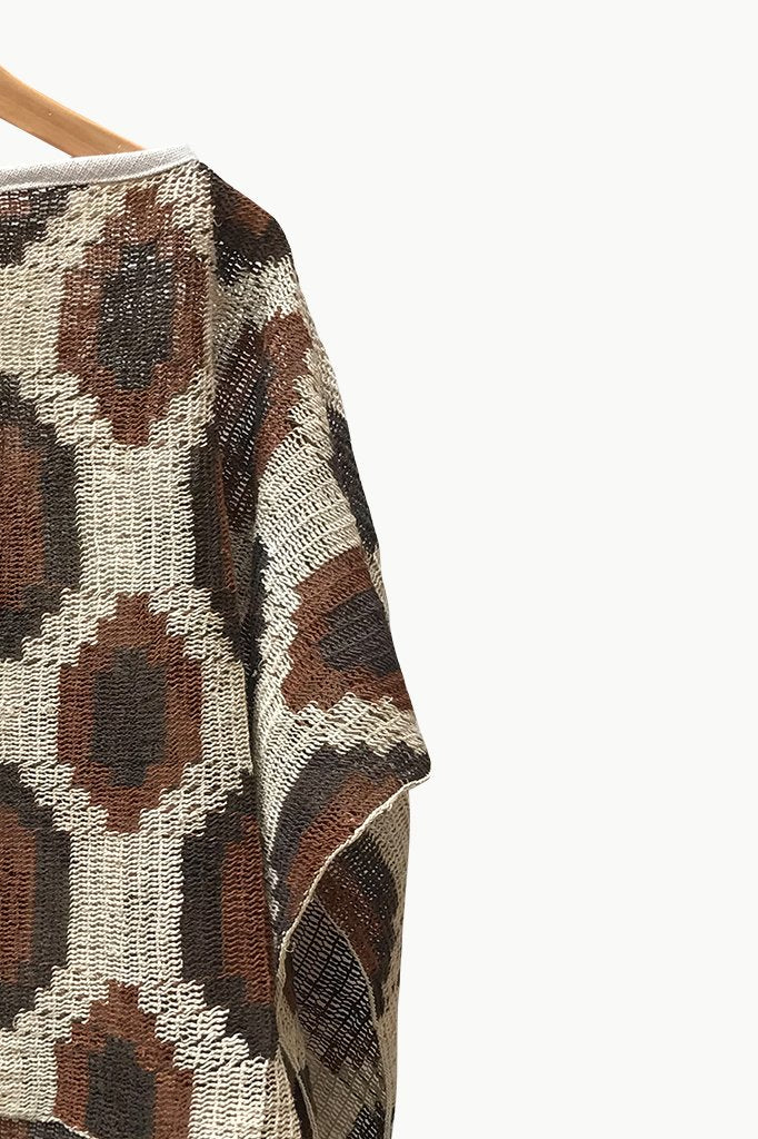 Close up of Cream Chaguar Poncho with Brown Hexagonal Design Details.