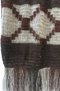 Close up Dark Brown Chaguar Shawl with Dark Brown and Cream Fringe Ends. Cream design details.