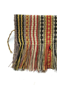 Close up Mulitcolored Patterned Chaguar Clutch Bag with Fringe ends.