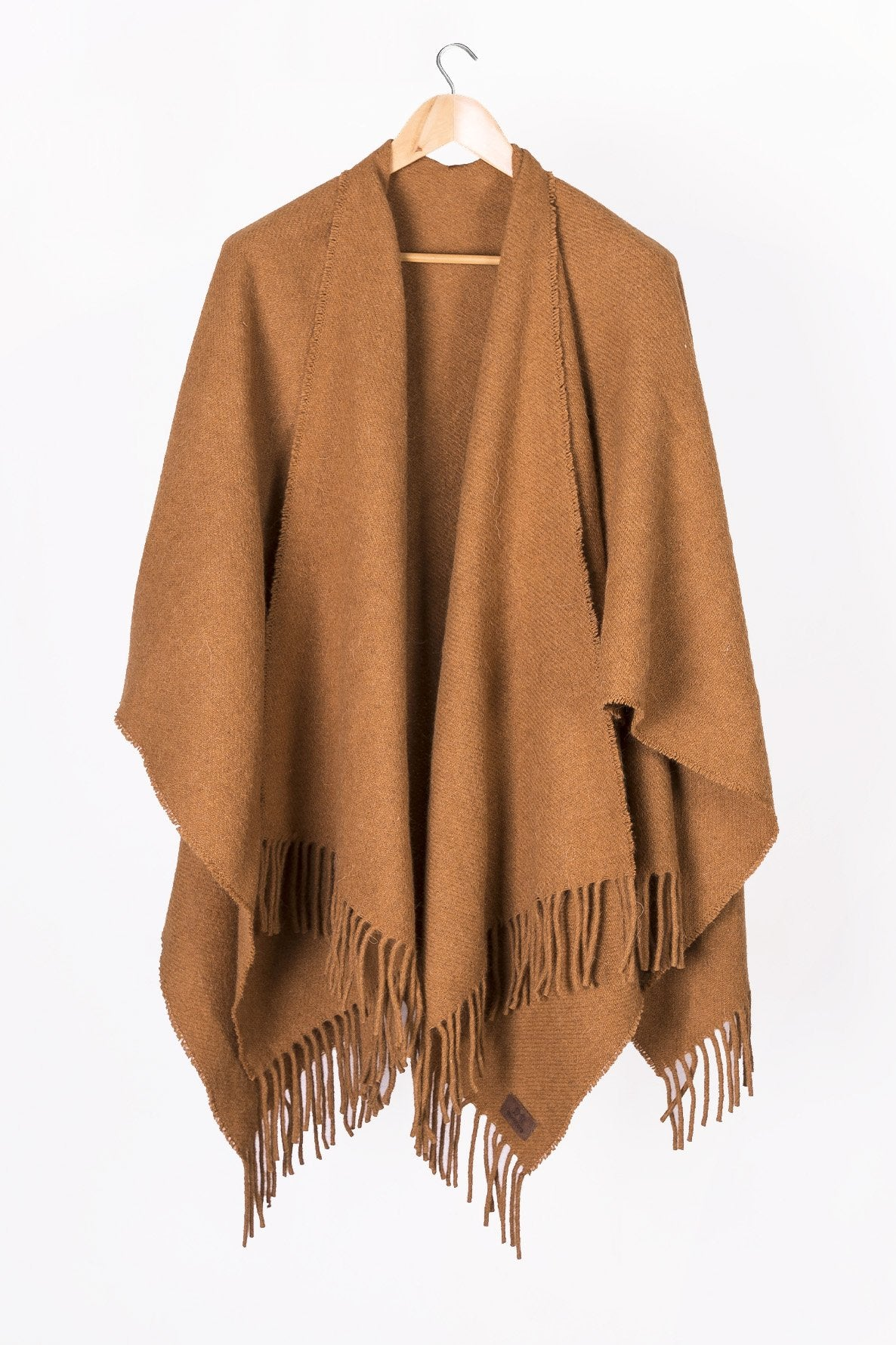 Caramel Llama and Sheep Wool Poncho on Hanger.