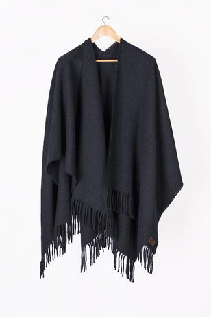 Black Llama and Sheep Wool Poncho on hanger.