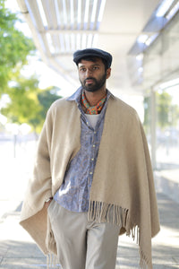 Male wearing Beige Llama and Sheep Wool Poncho with Fringe edges.