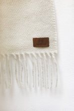 Load image into Gallery viewer, Close up of Fringe Ends and Label of Natural White Llama and Sheep Wool Poncho.