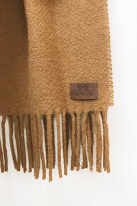 Close up of Caramel Llama and Sheep Wool Scarf. Wool Texture and Tag is shown.