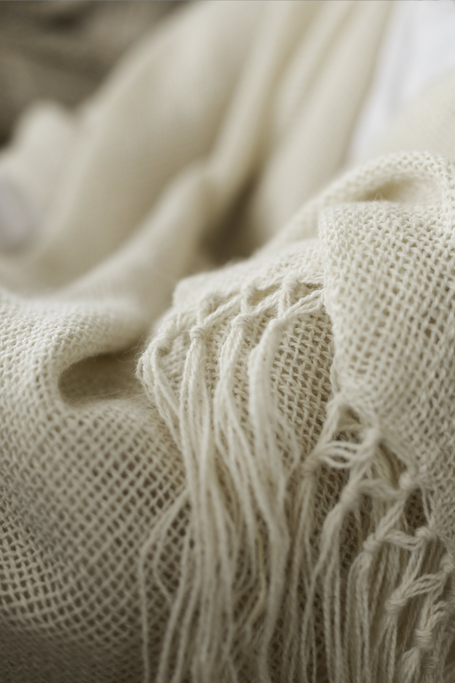 Close up of Fringe Ends of Natural White Llama Handwoven Poncho.