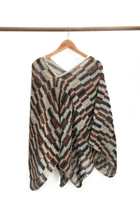 Cream Chaguar Poncho with Red and Black Striped Design Details.