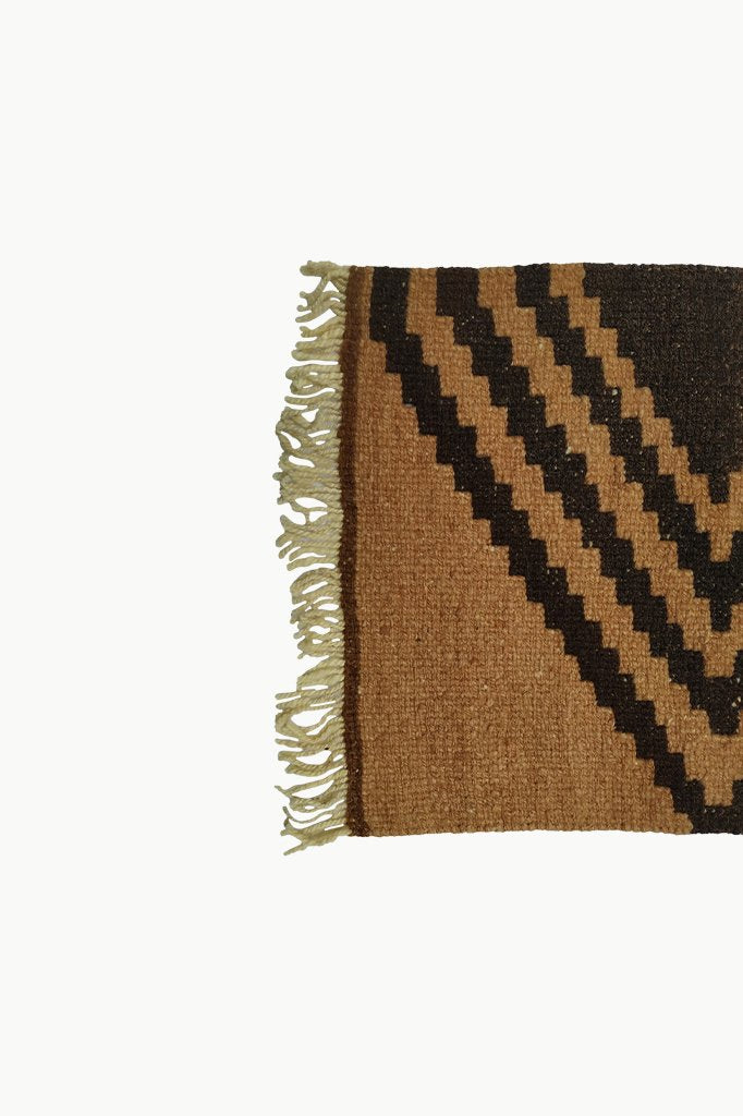 Close up of Fringe Ends of Ochre Special Size Wool Tapestry with Dark Brown Designs.