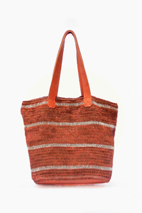 Orange Suri Purse with Thin White Stripes.