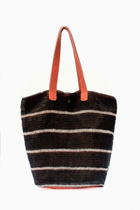 Black Suri Purse with White Stripes and Brown Leather Straps.