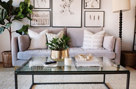 Clean simple lines dressed perfectly to add interest without dominating the room.   (Image – theeverygirl.com)