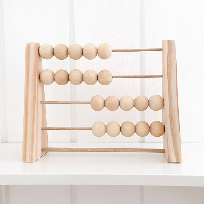 Natural wooden abacus on nursery shelf
