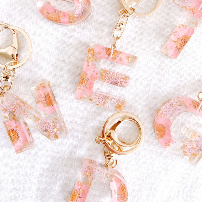 Floral resin keychain letters with gold clasp. Backpack accessories