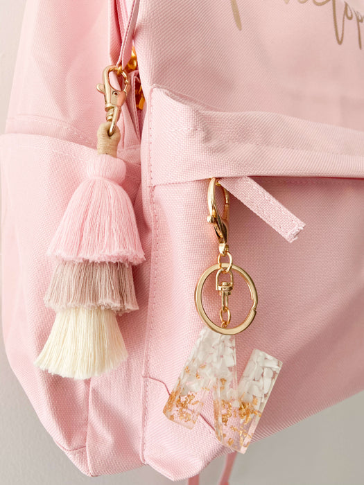 White resin letter keychain with dusty pink tassel keyring