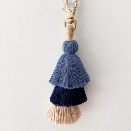 Navy and beige tassel keychain bag accessories for boys