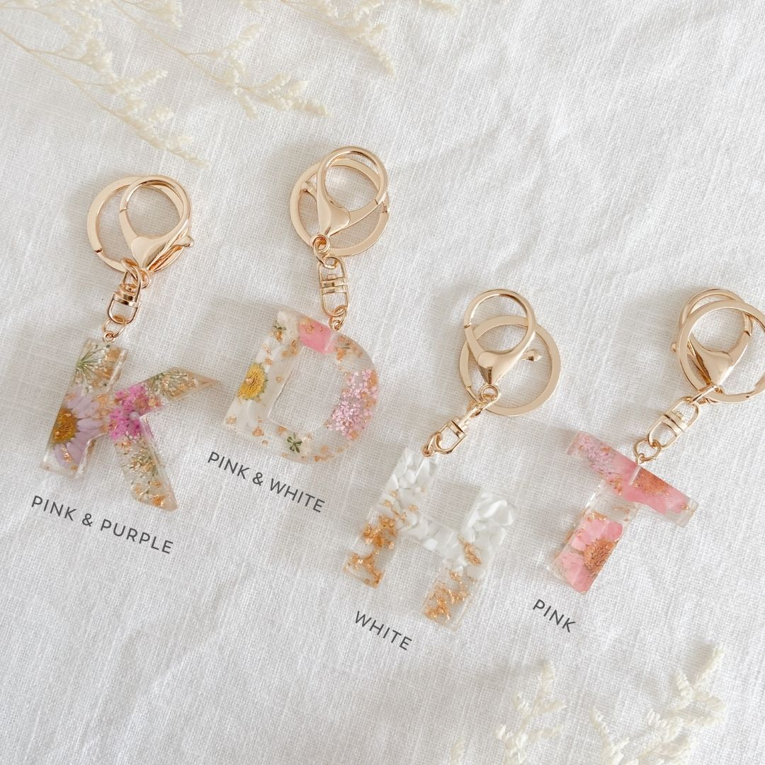 Backpack accessories for kid's. Letter initial keyrings with pressed flowers and gold leaf in resin