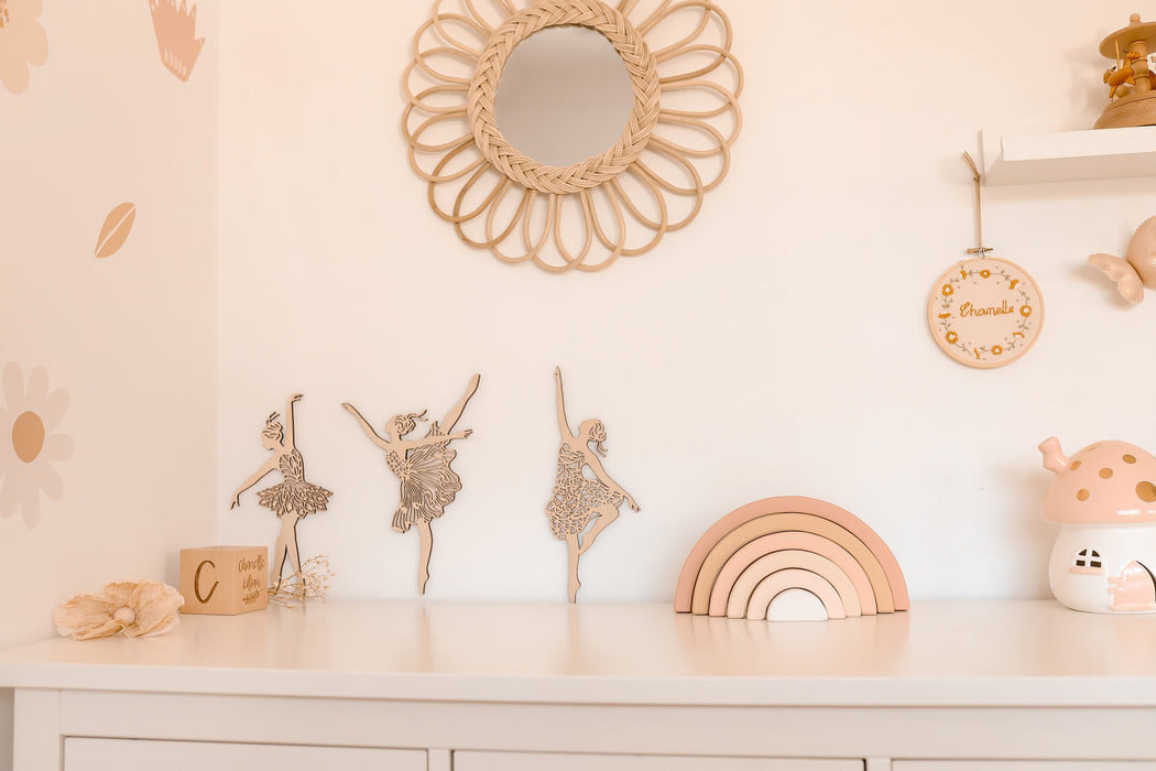 Girls pink ballerina bedroom. Matching pink decor such as wooden rainbow, ceramic mushroom and wall decals
