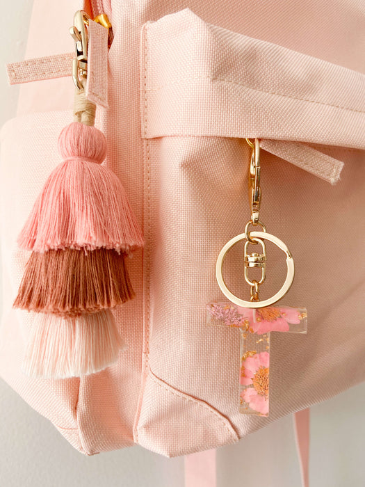 Kids backpack accessories. Pink letter resin keychain with earthy pink tassel keyring