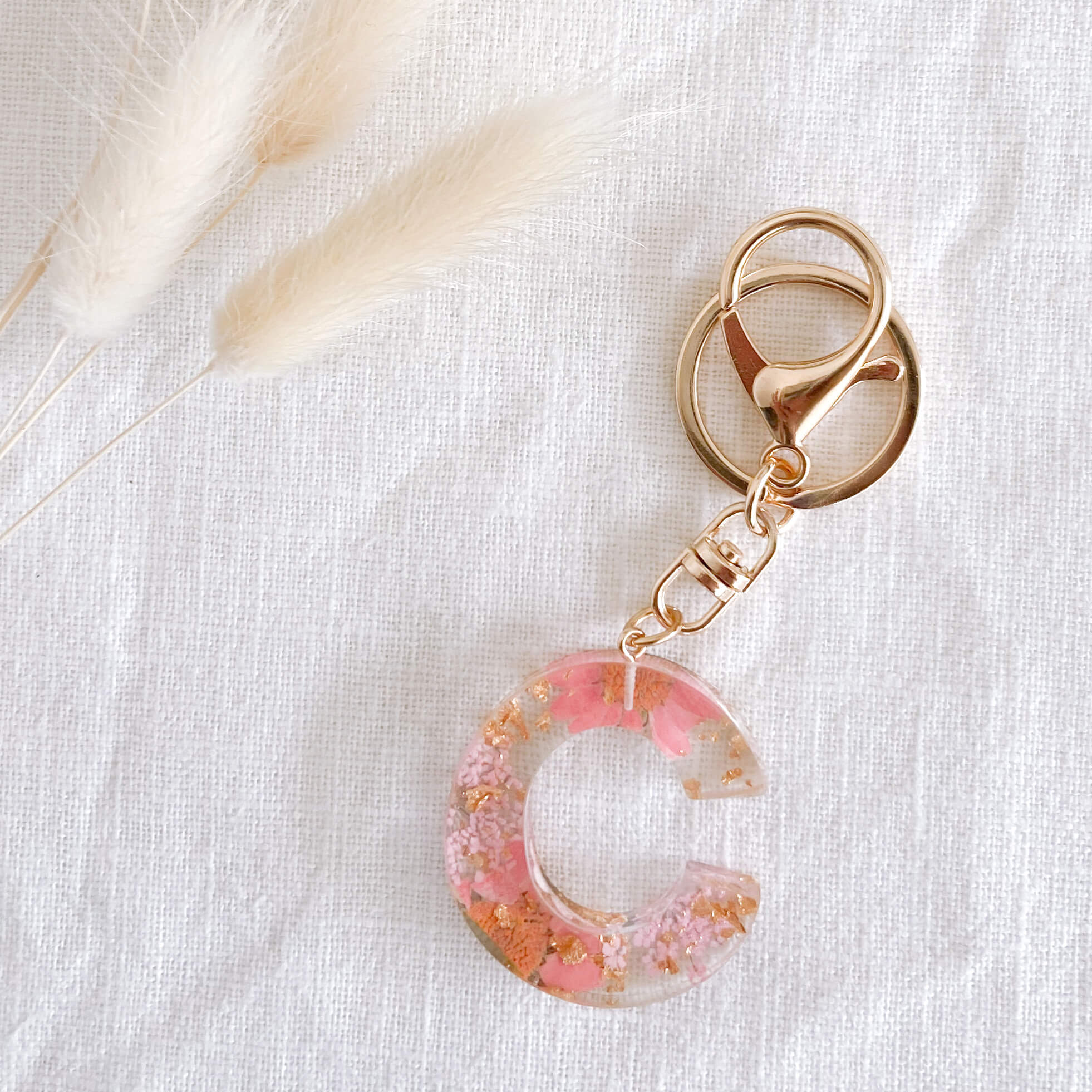 Pink Flower Keychain made from Resin with Gold clasp. Perfect for backpack, handbag or bag