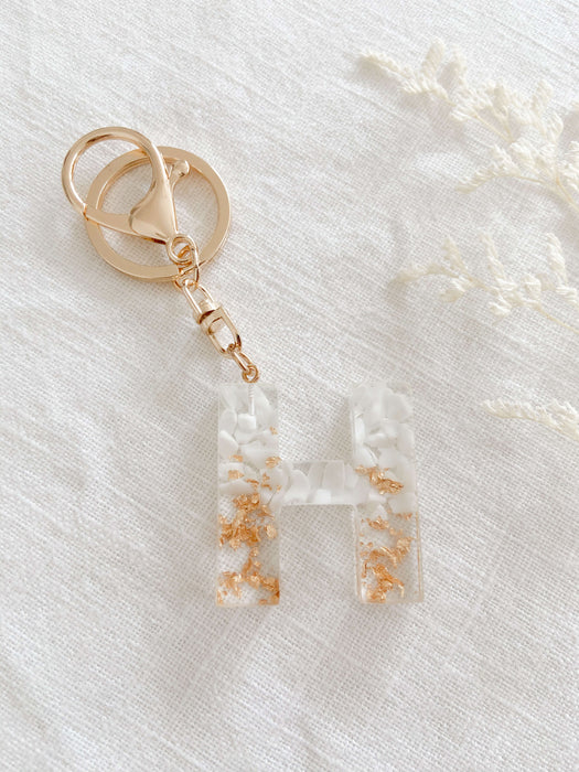 White and gold resin keychain for school bag or kids backpack