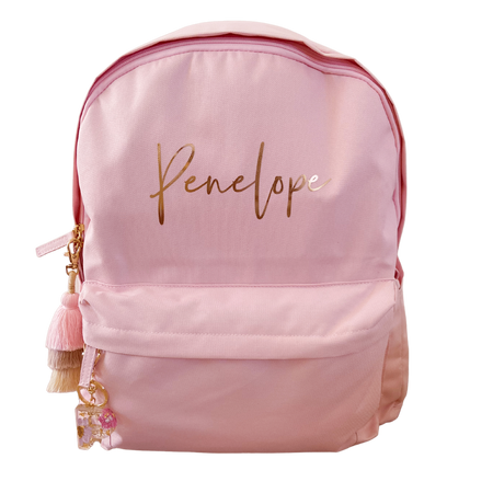 personalised pink kids backpack with tassel keychain and letter keychain name is in gold