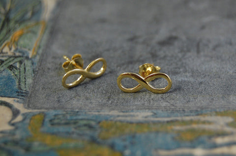 'infinity' earstuds (925 silver gold-plated)