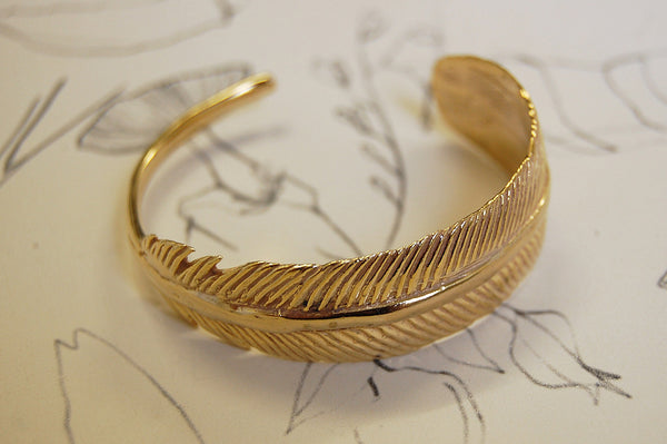 feather gold plated bracelet