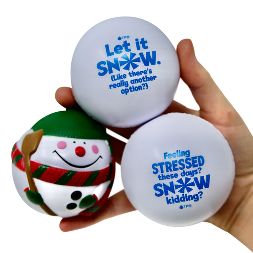 Adult hand holding 3 fun winter-themed snow ball stress balls gift set