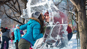 Two people kissing at an ice sculpture in Ottawa