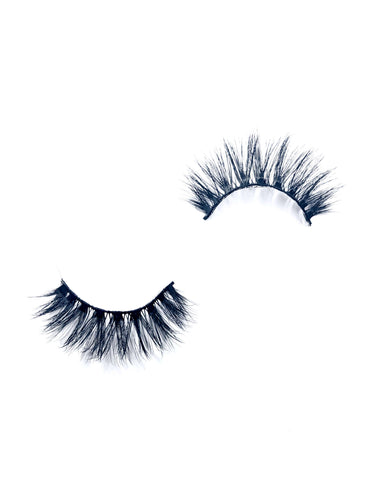 thick criss cross false eyelashes in the style nico, from dotted cosmetics