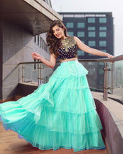 Load image into Gallery viewer, Stylish Net Multicoloured Ruffle Design Flared Lehenga With Choli Set - vezzmart