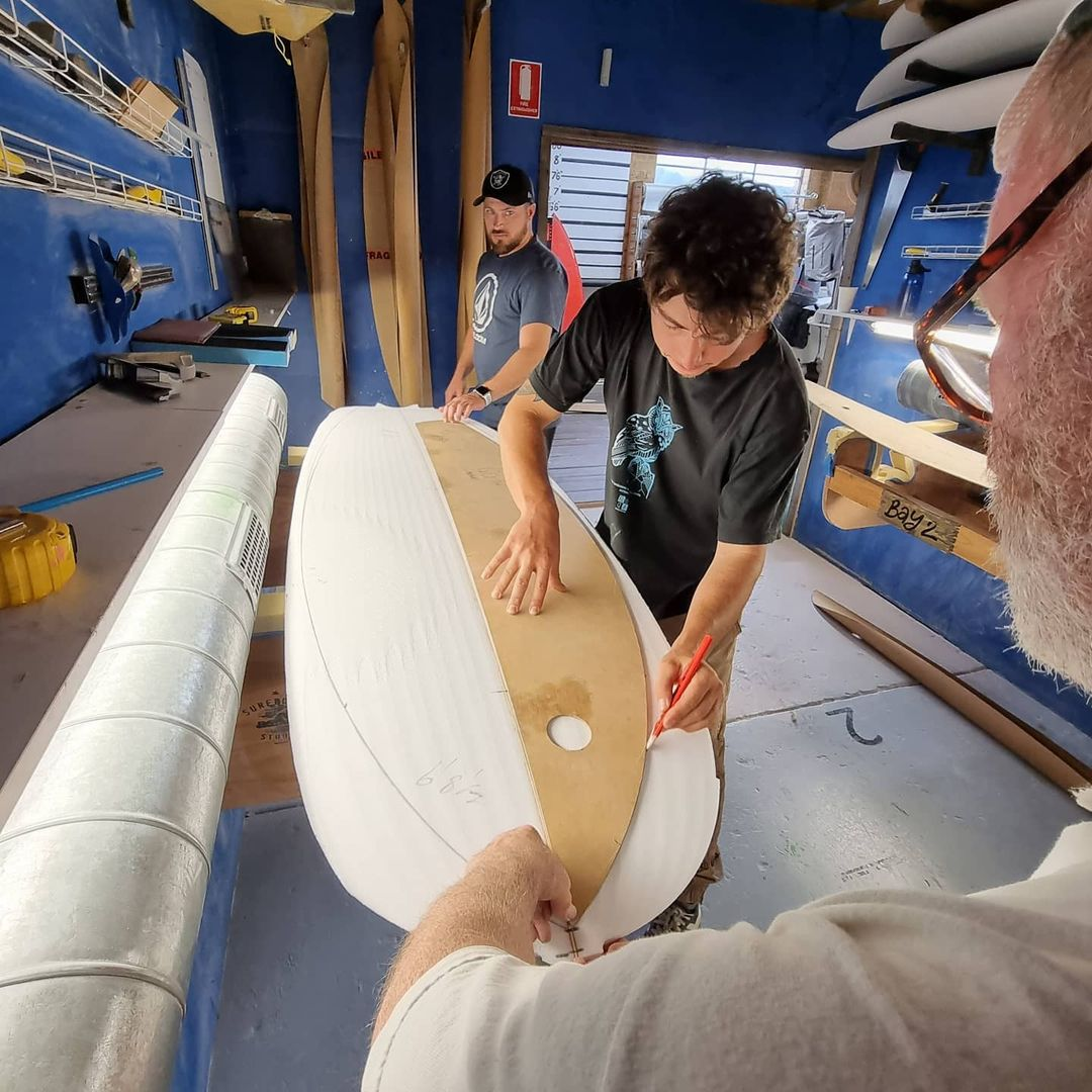 Using a template to design a surfboard at The Surfboard Studio - Group Course