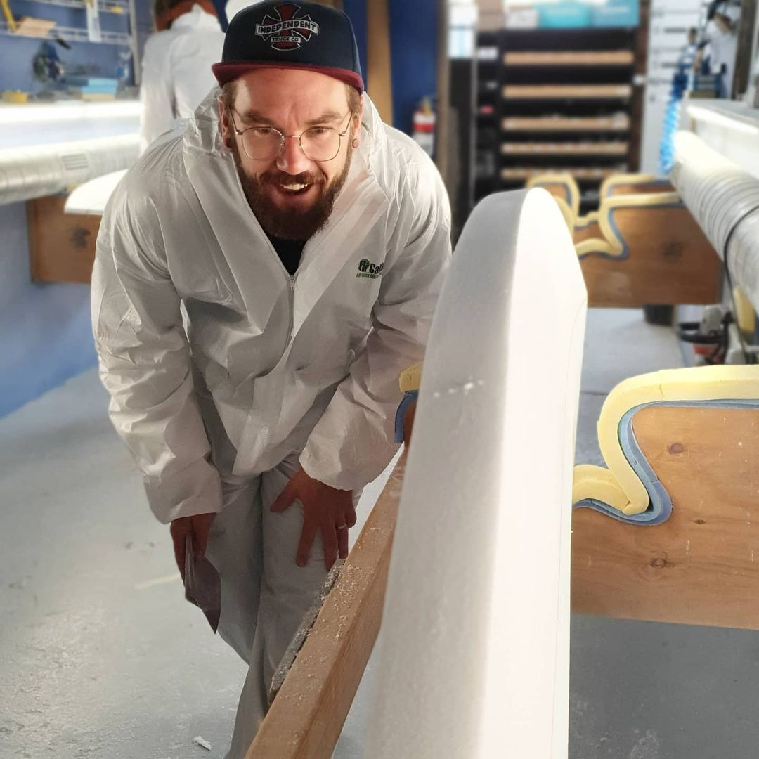 Checking the surfboard rail during The Surfboard Studio Private Group Course