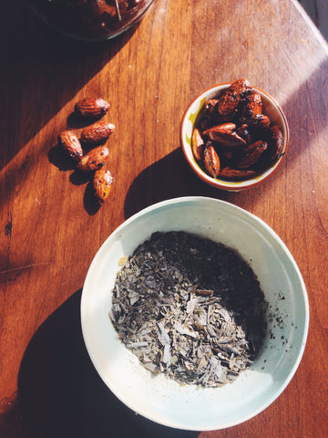 Bowls of flaked sugar kelp and roasted almonds radiate health and joy