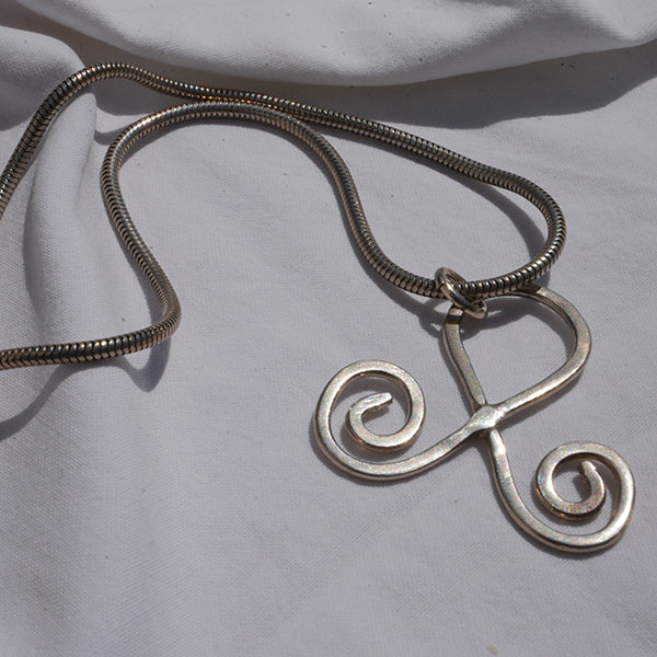 curved motif on silver chain